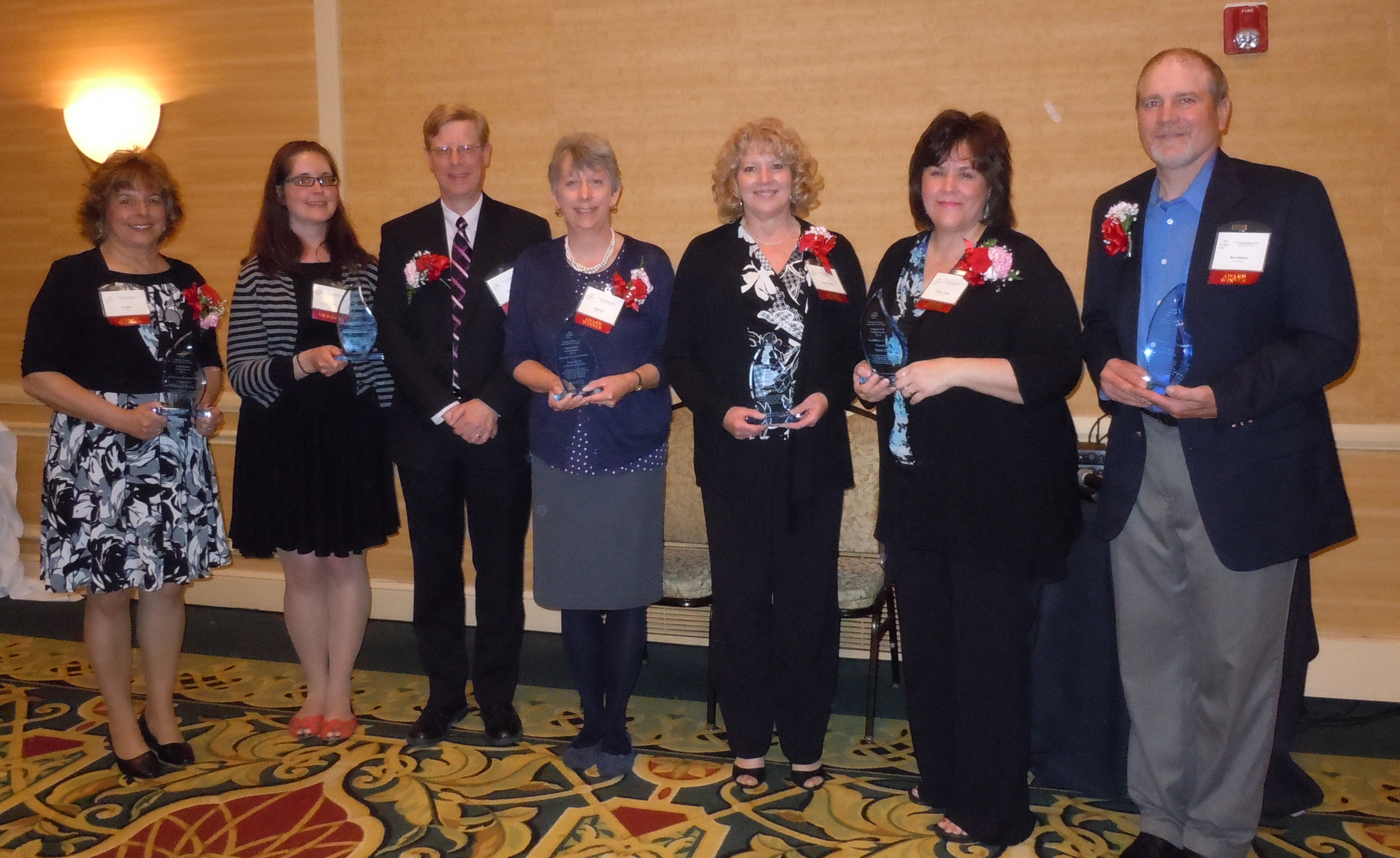 Beth Glas and Steve Hansler (second and third from left) with the other recipients of WRAAA's 2014 Independent Living Awards.
