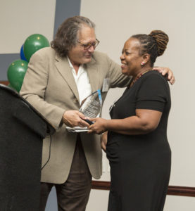 Steve Weingrad presents the Maximum Access Award to Pam Ashby of the Cleveland HUD Field Office.